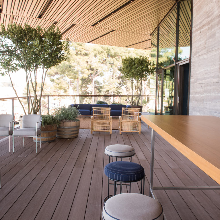 Composite wood decking envelops the Grand Park Hotel